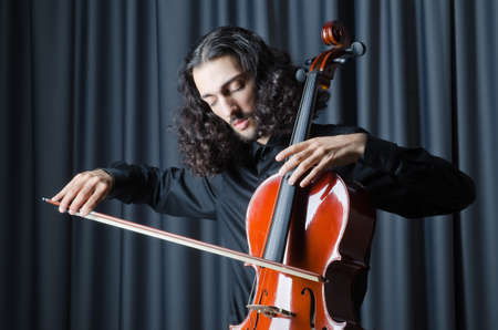 solo violinist: Man playing the cello Stock Photo