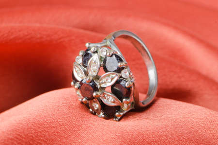 Jewellery ring on the satin background photo