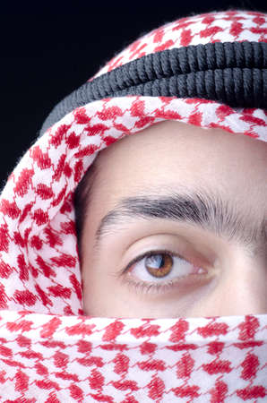 Man in arab clothing photo