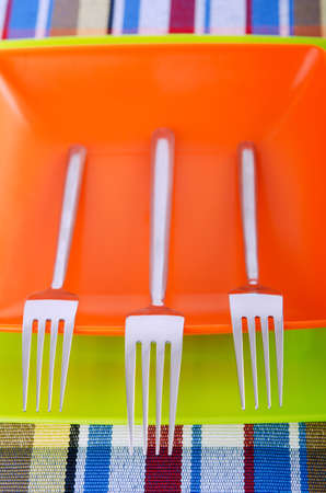 Emtpy plates with utensils on table photo
