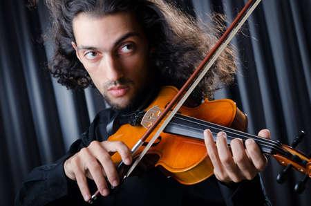 violin player: Young violin player playing