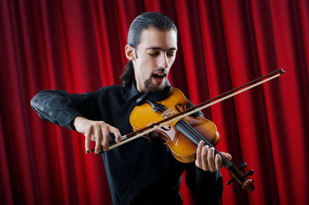virtuoso: Young violin player playing