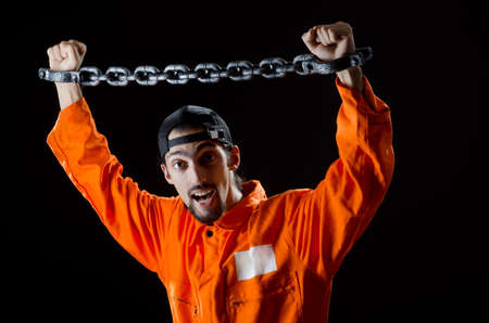 Inmate chained on black background Stock Photo
