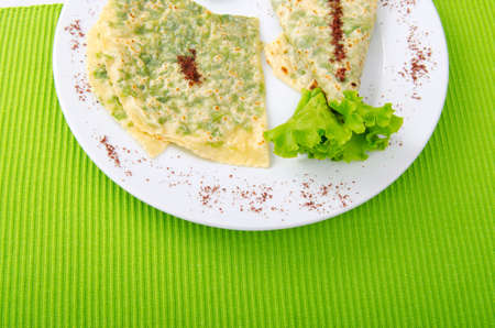 Herb stuffed pancaces in the plate photo