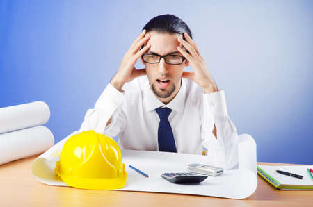 Young engineer looking at drawings Stock Photo - 11622105