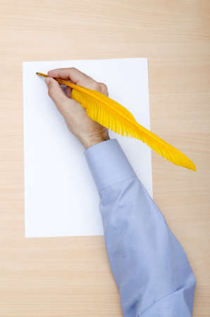 Man with quill writing Stock Photo - 11572185