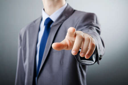 pushing the button: Businessman pressing virtual buttons Stock Photo