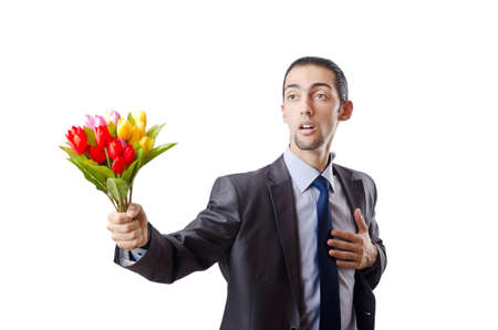 Young man with tulip flowers photo