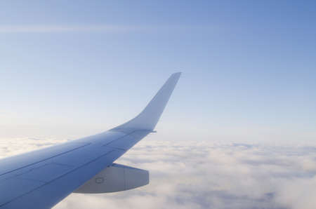 Wing of airplane from window Stock Photo - 11572434