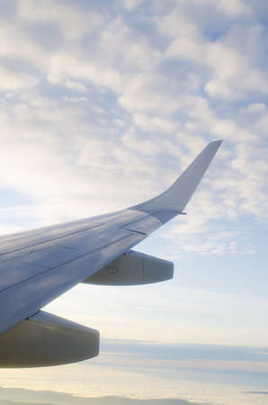 Wing of airplane from window Stock Photo - 11572432