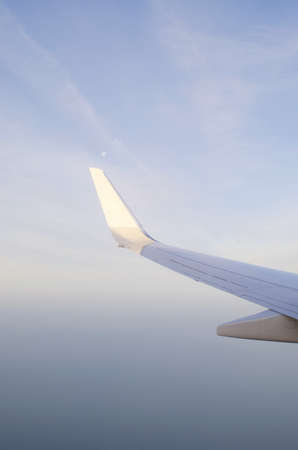 Wing of airplane from window Stock Photo - 11572449