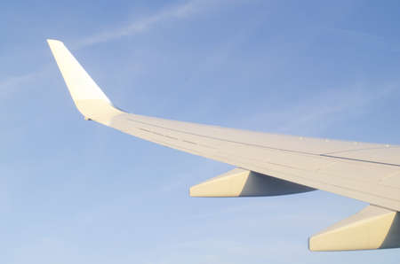 Wing of airplane from window Stock Photo - 11572220