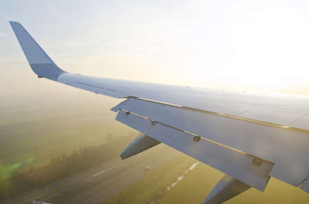 Wing of airplane from window Stock Photo - 11572437