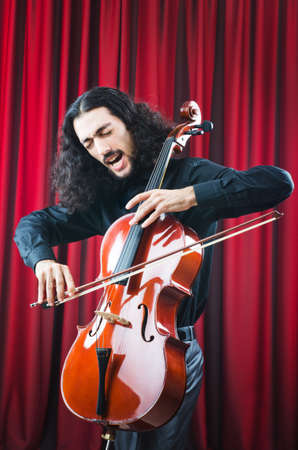violin player: Man playing the cello Stock Photo