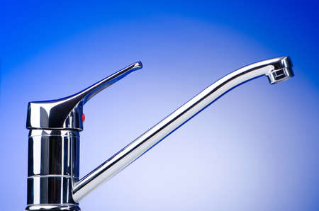 Chrome tap against the background photo