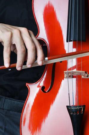 virtuoso: Man playing the cello Stock Photo