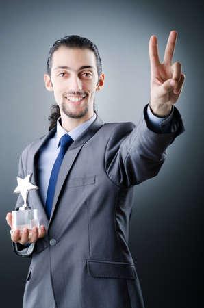 Businessman awarded with star award photo