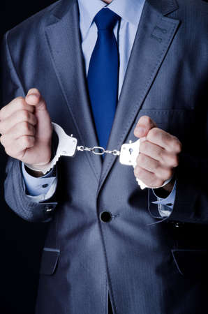 handcuffed: Businessman jailed for his crimes Stock Photo