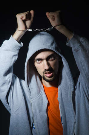Young criminal with handcuffs photo