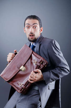 Business spy with briefcase photo
