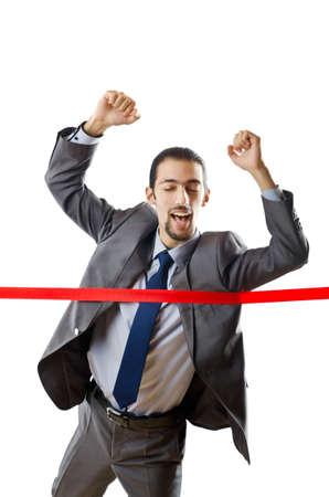 Businessman crossing finish line photo