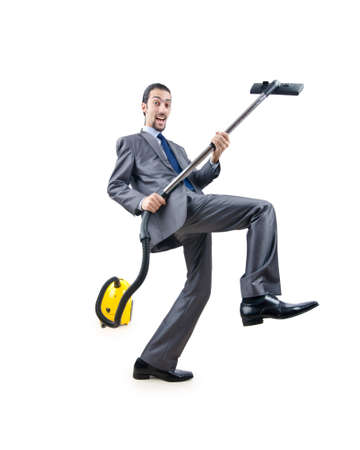 Businessman with vacuum cleaner on white photo
