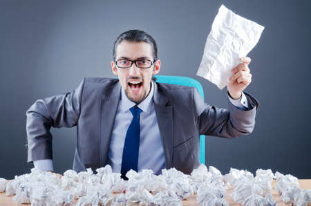 Businessman throwing paper away photo