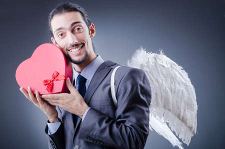 Man with wings and giftbox Stock Photo - 11622503