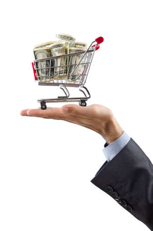 Shopping cart full of money photo