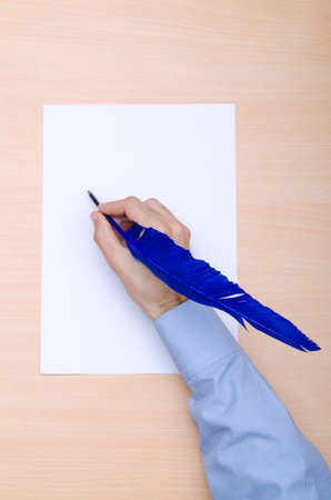 Man with quill writing photo