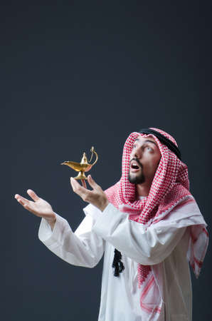 Portrait of young arab with lamp photo