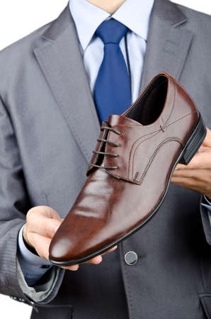 Man with a selection of shoes Stock Photo