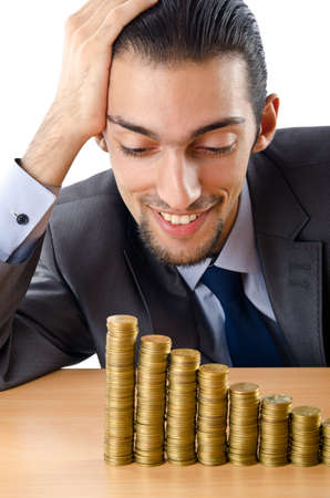 Growth concept with coins and businessman photo