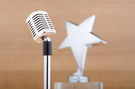 awards ceremony: Star award against wooden background