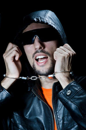 Young criminal with handcuffs Stock Photo - 12123264