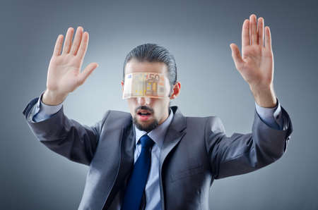 Businessman blinded with money photo