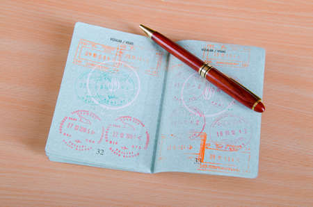 Passport with airport stamps Stock Photo - 12109686