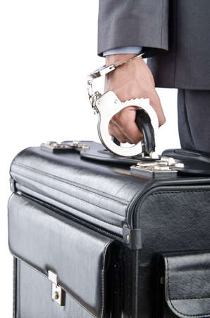Man with briefcase and handcuffs photo