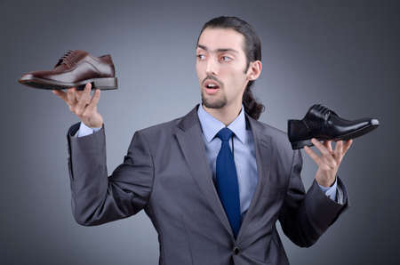 Man with a selection of shoes Stock Photo - 12130756