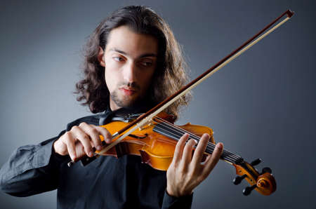 Violin player playing the intstrument photo