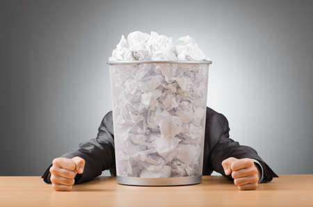 Man with lots of wasted paper Stock Photo