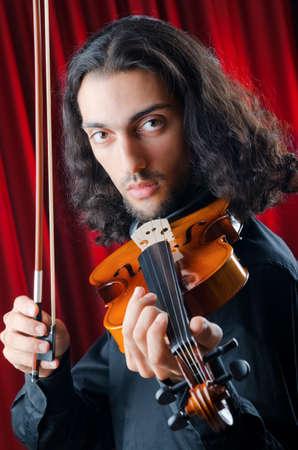 violin player: Violin player playing the intstrument
