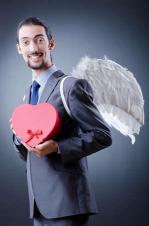 Man with wings and giftbox photo