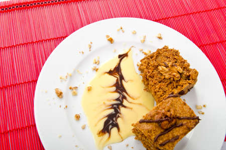 piecies: Cake with sweet sauce in plate