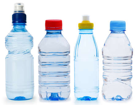 Many water bottles isolated on white photo