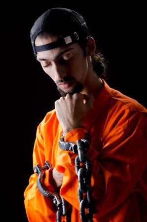 jailbird: Inmate chained on black background Stock Photo
