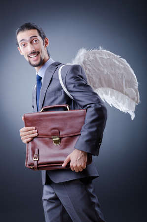 Business angel with money photo