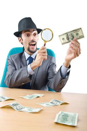 detecting: Detective detecting fake dollar banknotes