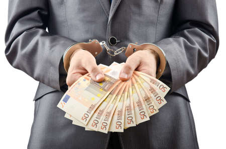 Handcuffed man with euro banknotes photo
