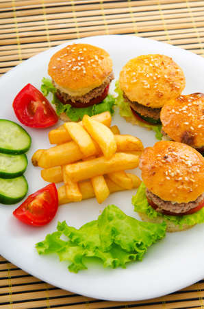 Plate with tasty mini burgers Stock Photo - 12227385